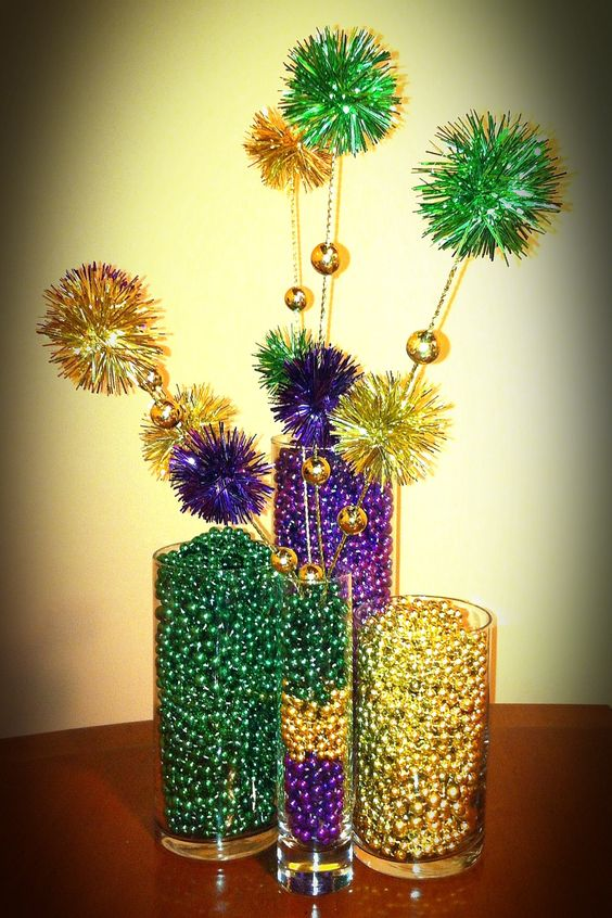 This DIY bead vase centerpiece with Mardi Gras beads is simple but looks so festive.