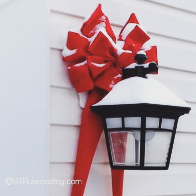 Decorating with bows on outdoor lights